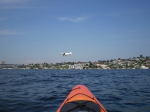 Watching float planes from a kayak on Lake Union