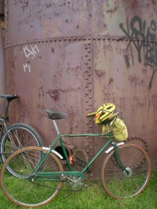 Not my bike, but: A bike leans against the coal plant at Gas Works Park during Tour de Fat.